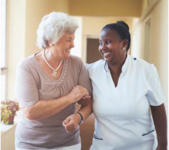 caregiver assisting elderly woman